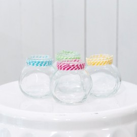 Set of colourful small glass jars
