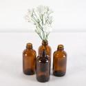 Rent: Vintage Amber Glass Bottles (set of 4)