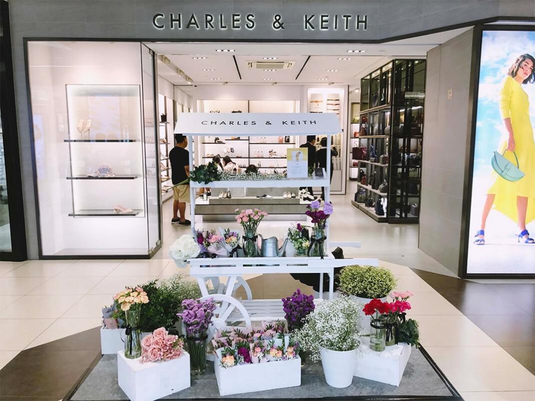 Windflower Florist using White Push Cart at Charles & Keith